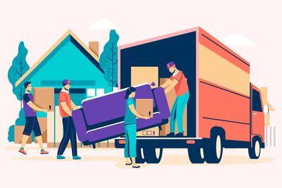 Personas llenando un camión de mudanzas con cajas y muebles
